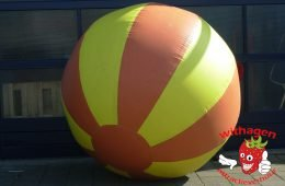 Wereldbal spel bruin-geel huren